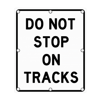 TS40 Flashing Do Not Stop on Tracks Sign Day